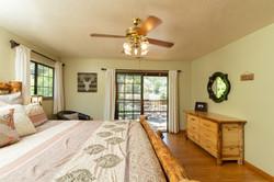 Riverhouse Master Bedroom with Sliding D