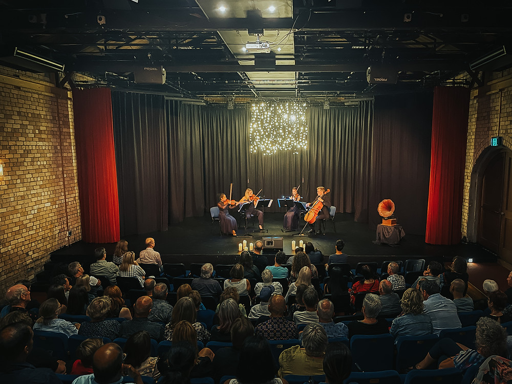 the Arcus Quartet on stage at the PumpHouse Theatre in Takapuna, playing to a full audience.