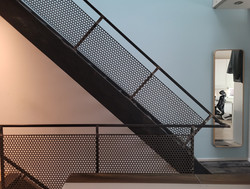 Townhouse perforated steel stair railing
