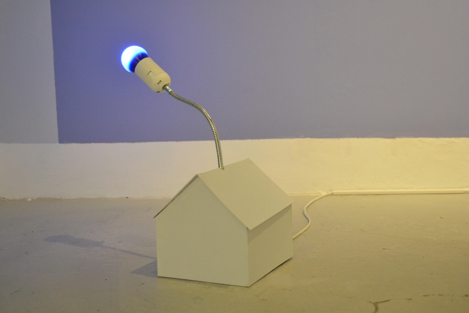 Paper model with a blue light bulb