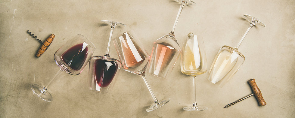 Flat-lay of red, rose and white wine in