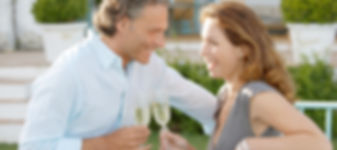 Mature couple toasting with champagne wh