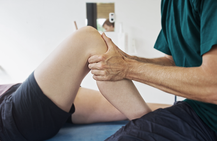 Physiotherapist manipulating a leg