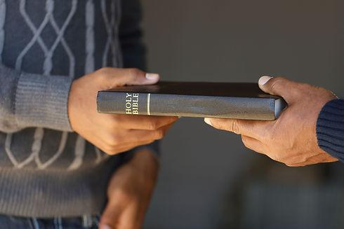 handing a book.jpg