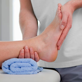 Therapist is holding the patient foot