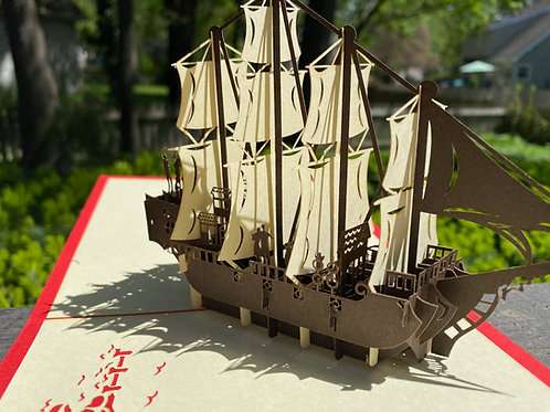 Brown Ship with White Sails