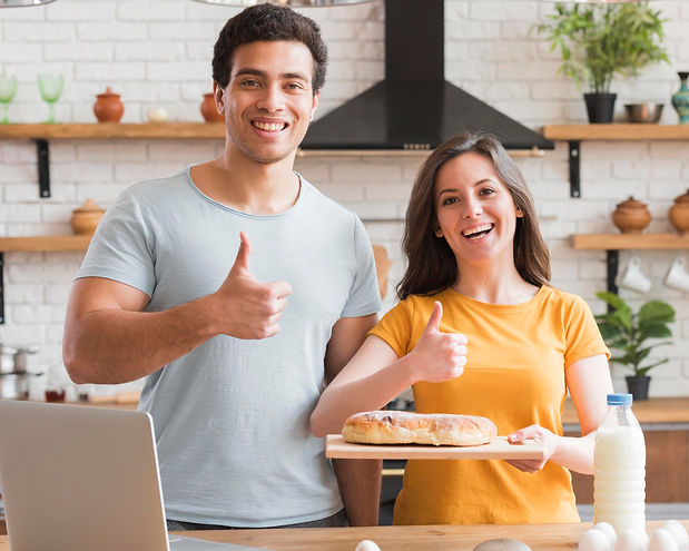 thumbs-up-gesture-couple-cooking-a-bread
