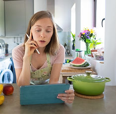excited-woman-watching-online-cooking-cl