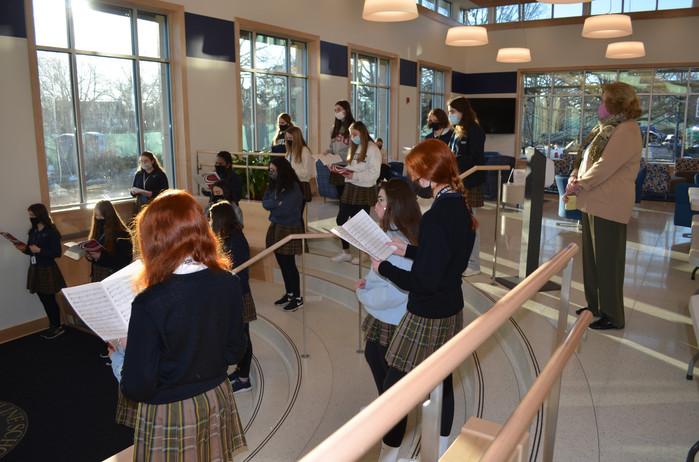 Choirs rehearse in the Kulsar-McCarthy Lobby