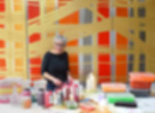 Artist Julia Brooker in her studio making her paintings on aluminium