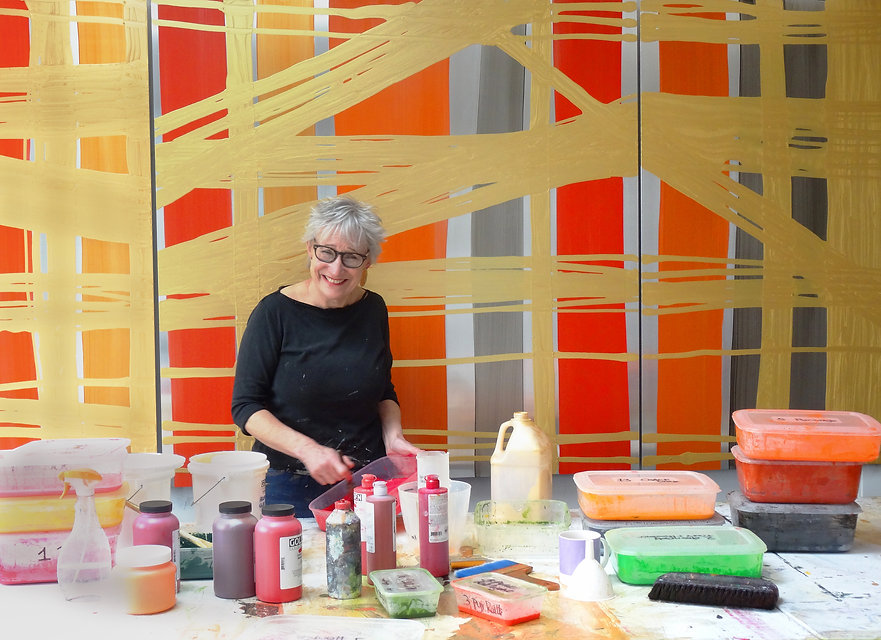 Artist Julia Brooker in her studio making her paintings on aluminium