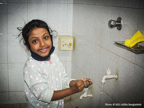 Raisa is washing her hands.jpg
