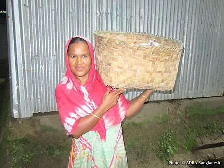 Jhorna with her cloth basket.jpg