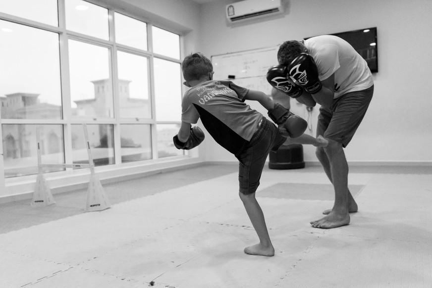 dad and son kickboxing Doha