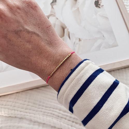 Bracelet perles dorées - Rose fluo
