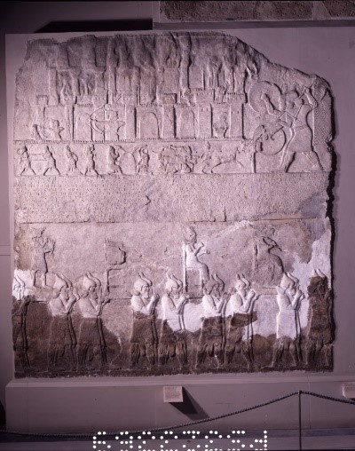 Assyrian Wall relief from Nimrud, Iraq, showing the removal of captured gods. British Museum number 118931. Copyright Trustees of the British Museum.