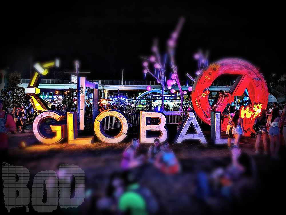 "Global Dance Festival glowing ""Global"" signage at the event."