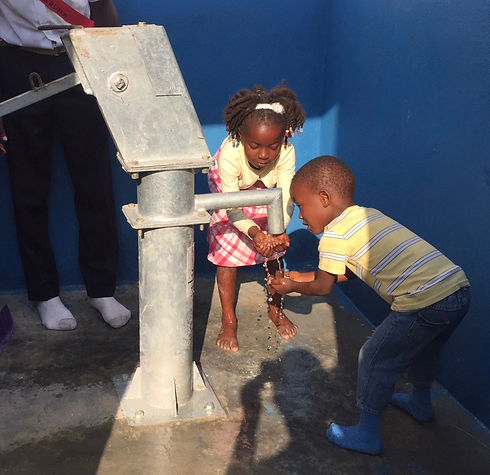 edited Inauguration #3 getting water 2 1.46.49 PM.jpg