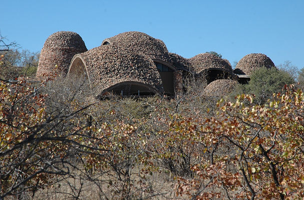 building nestled in the lanscape as seen from a game drive.JPG