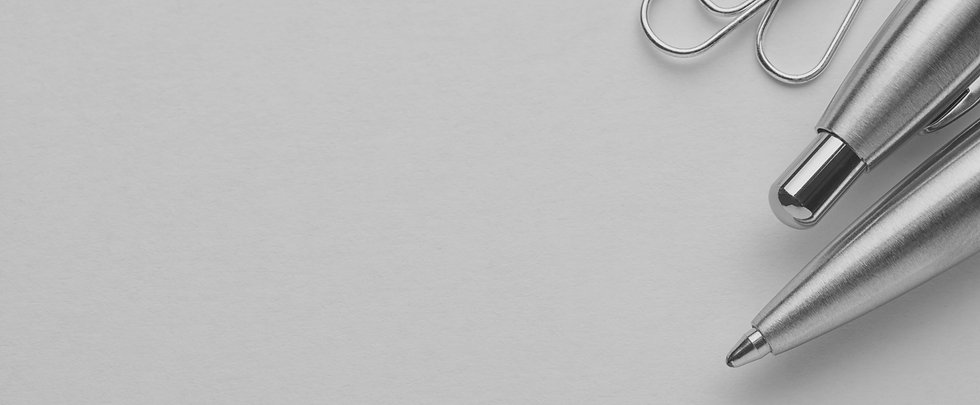 metal-ballpoint-pen-and-paper-clips-on-w