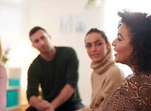 woman-speaking-at-support-group-meeting-