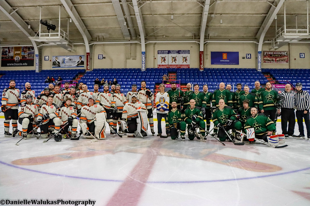 The Johnstown Generals and Flyers gather together to take a group team picture at 1st Summit Arena in Johnstown Pa