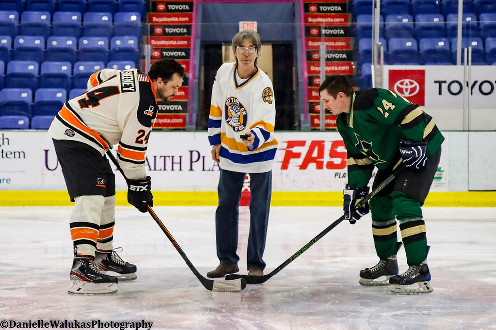 Steve Carlson from Slap Shot fame drops the puck before a home game with the Johnstown Generals.