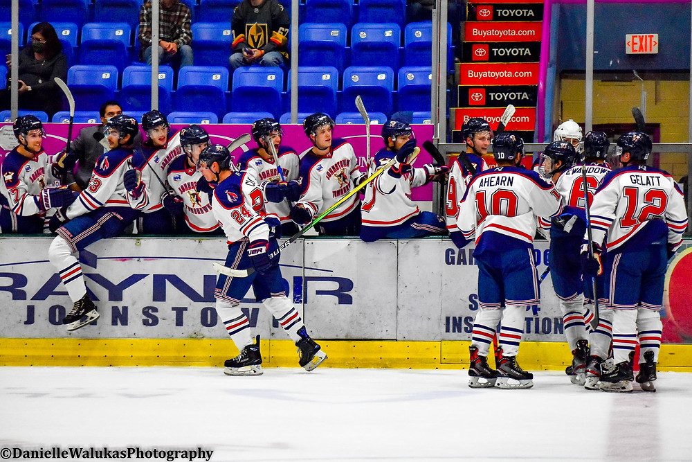 Johnstown Tomahawks celebrate a goal as a team while playing at 1st Summit Arena in Johnstown Pa