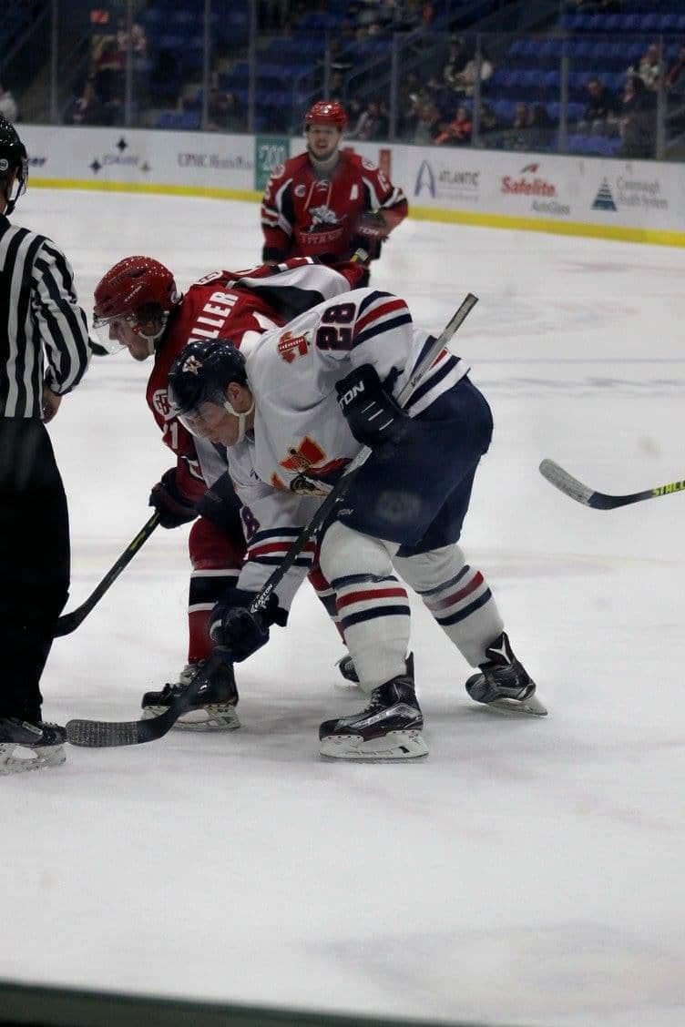 Luke Lynch taking a faceoff as a Tomahawk vs the New Jersey Titans.