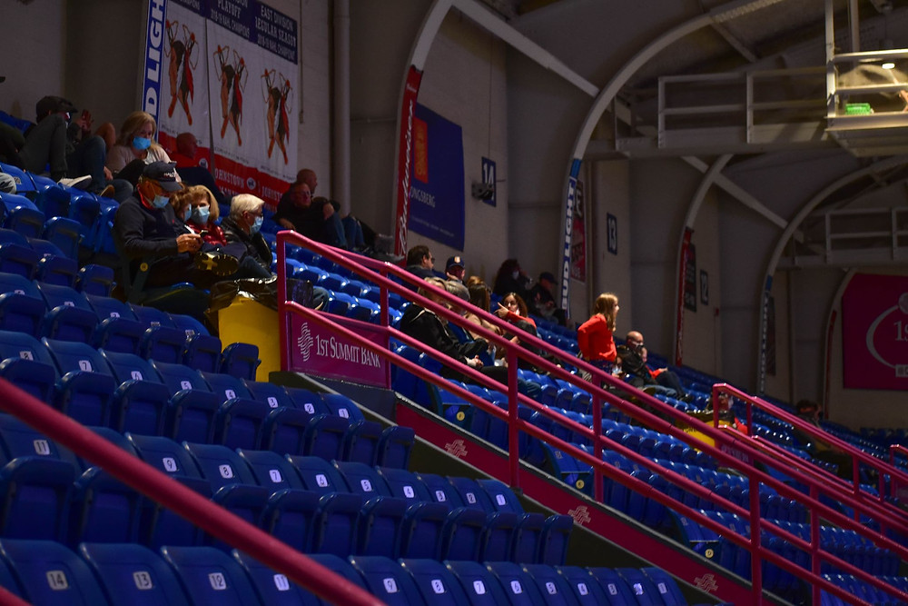 Fans practicing Covid-19 social distancing prior to an NAHL Johnstown Tomahawks ice hockey game.