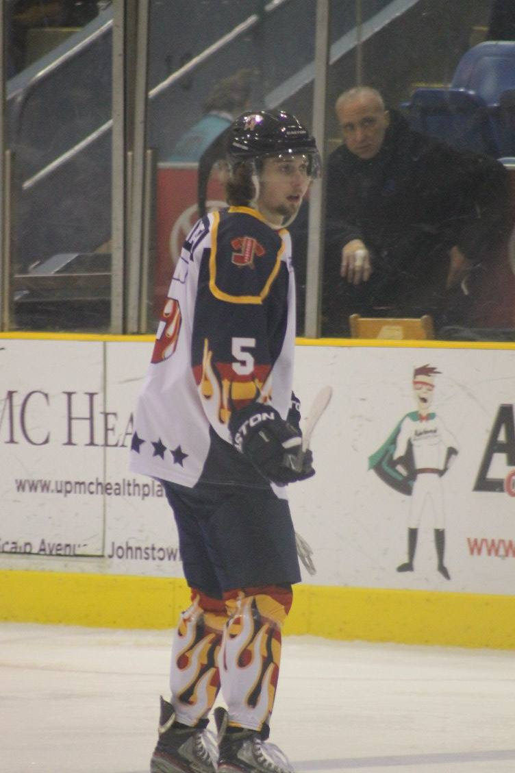STEVEN QUAGLIATA in the middle of action with the Johnstown Tomahawks
