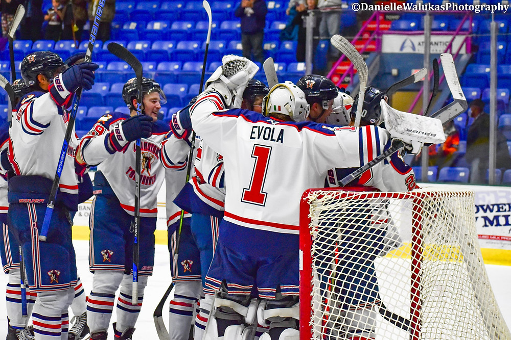 Players, including Sam Evola, celebrate after a win during the 2020-21 NAHL season for the Johnstown Tomahawks.