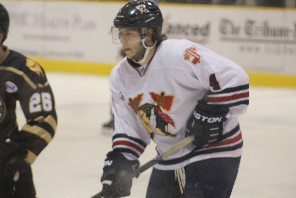 Ian Spencer lining up for a faceoff while playing for the Johnstown Tomahawks