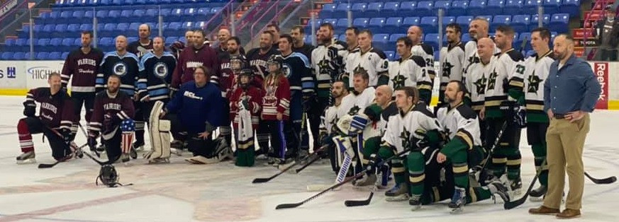 Players from both the Johnstown Generals and the Johnstown Warriors meet at center ice after their Charity game on October 28 2020.