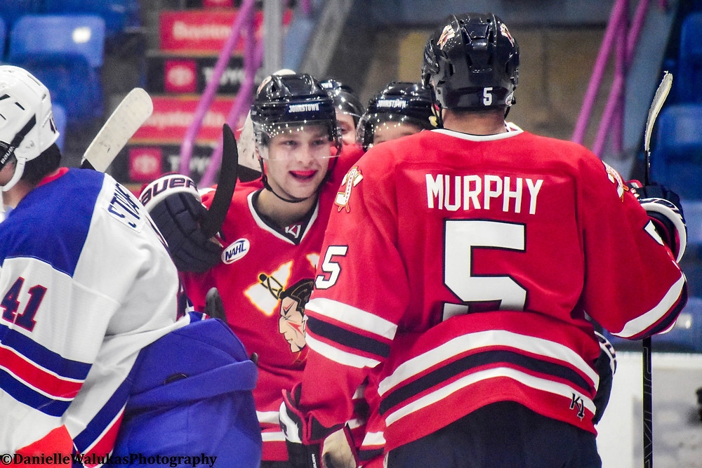 Andrew Murphy, player for the NAHL Johnstown Tomahawks celebrates with teammates after scoring a goal against the USA under 18 hockey team.