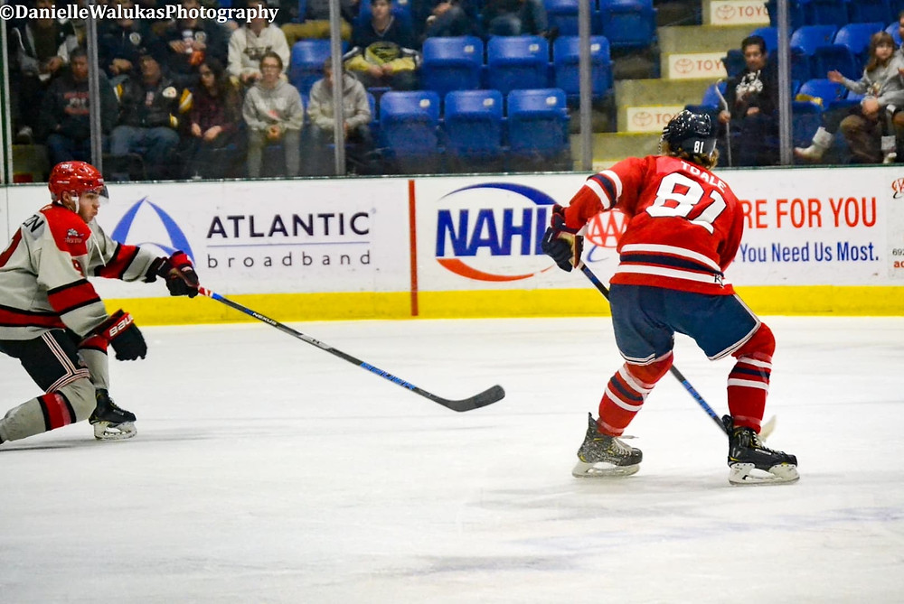 Johnstown Tomahawks player, HUNTER TOALE looking for a shot against New Jersey Titans of the NAHL