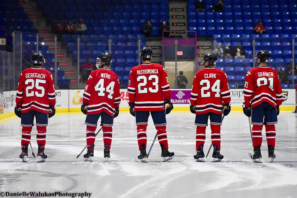 Players lineup on the blue line for the Johnstown Tomahawks awaiting the start of the ice hockey game.