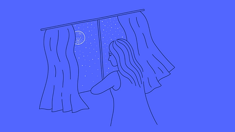mixkit-woman-staring-out-the-window-looking-at-the-night-sky-25-original.png