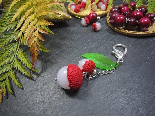 Bijoux de sac, letchis & feuille verte