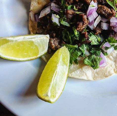carne asada street taco with red onion, cilantro and lime