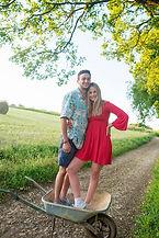 couple standing in a wheelbarrow