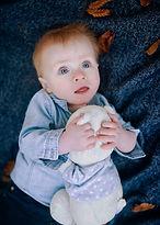Newborn holding a teddy bear