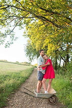 couple hugging in a wheelbarrow