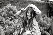 black & white portrait of a girl laughing naturally