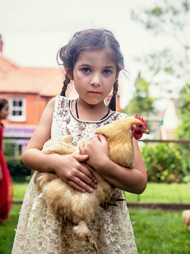 Portrait holding a chicken, because, well, why not?