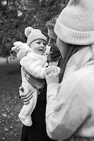 black & white portrait of newborn with mum and dad