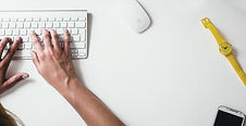 fingers on typing keyboard