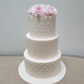 Sugar rose and pearl white wedding cake