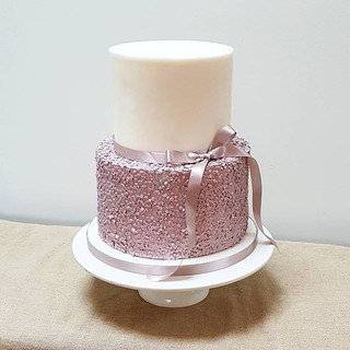 Sequin sparkle cake in rose quartz with simple bow- sadly I couldn't catch the sparkliness in the photo! #sparklecake #sequincake  #weddingc