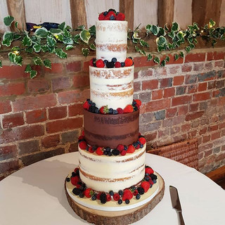 FOur tier semi naked cake with berries